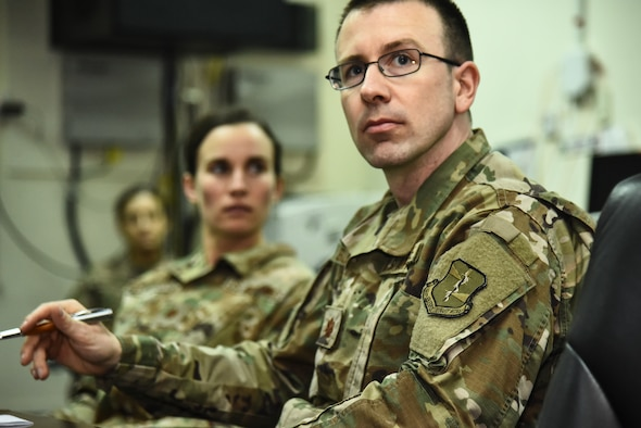 Maj. Vito Bussmann, 380th Air Expeditionary Wing chief of Plans and Programs attends a conference call at Al Dhafra Air Base, United Arab Emirates, Mar. 18, 2019. The 380th AEW plans and programs shop, also known as XP, is responsible for developing base's plans, programs and policies; coordinating programming actions to resolve issues; and constantly analyzing the effectiveness of these programs. (U.S. Air Force photo by Senior Airman Mya M. Crosby)
