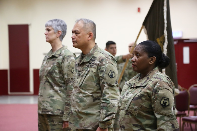 Outgoing Command Chief Warrant Officer Five Martha Ervin, right, 7th Mission Support Command Deputy Commander Col. Alex Wells, and incoming Command Chief Warrant Officer Five Vikki Hecht take their official positions during the Change of Responsibility ceremony March 23 at the Kaiserslautern Community Activity Center, Germany.