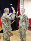 Col. Alex Wells, deputy commander of the 7th Mission Support Command, administers the Warrant Officer Oath of Office to Chief Warrant Officer Five Vikki Hecht, as she assumed the role of Command Chief Warrant Officer of the 7th MSC during a ceremony March 23 at the Kaiserslautern Community Activity Center, Germany.
