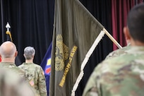 Chief Warrant Officer Five Martha Ervin relinquished responsibility to Chief Warrant Officer Five Vikki Hecht by the symbolic passing of the Warrant Officer Guidon during the Change of Responsibility ceremony March 23 at the Kaiserslautern Community Activity Center, Germany.
