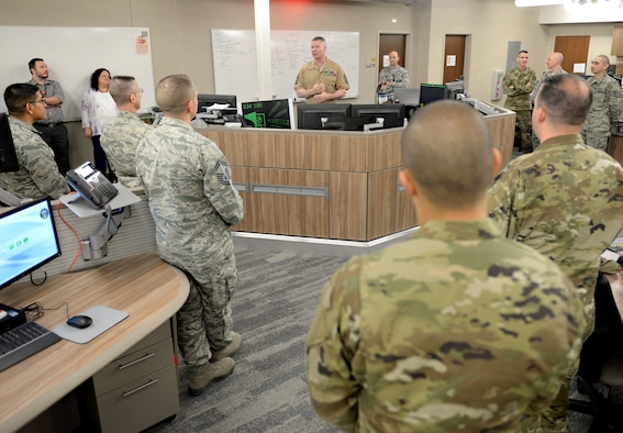 Master Gunnery Sgt. Scott Stalker, U.S. Cyber Command and National Security Agency command senior enlisted leader, greets members of the 834th Cyberspace Operations Squadron at Joint Base San Antonio-Lackland, Texas, March 21, 2019. During his visit, Stalker met with cyber Airmen to learn more about their unit's missions. (U.S. Air Force photo by Tech. Sgt. R.J. Biermann)