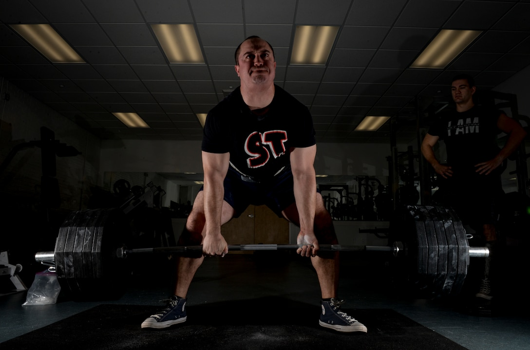 Staff Sgt. Thomas Buena, 14th Contracting Squadron NCO in charge of Base Operating, Support and Services team, performs a deadlift while and 2nd Lt. Brett Albertson, 14th Civil Engineer Squadron chief of project management, watches March 7, 2019, on Columbus Air Force Base, Mississippi. Buena later competed in the USA Powerlifting Military Nationals event and had a combined 1,593 pounds between his squat, deadlift and bench press. (U.S. Air Force photo by Tech. Sgt. Christopher Gross)