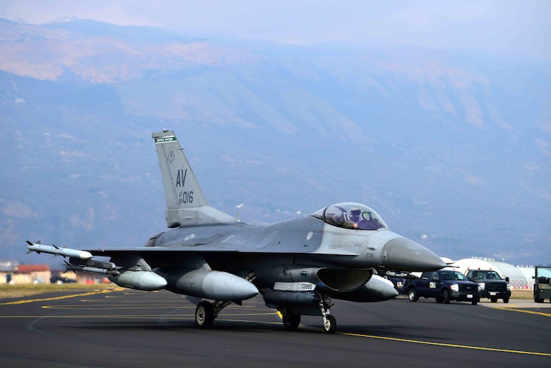 An F-16 Fighting Falcon taxis to a runway at Aviano Air Base, Italy