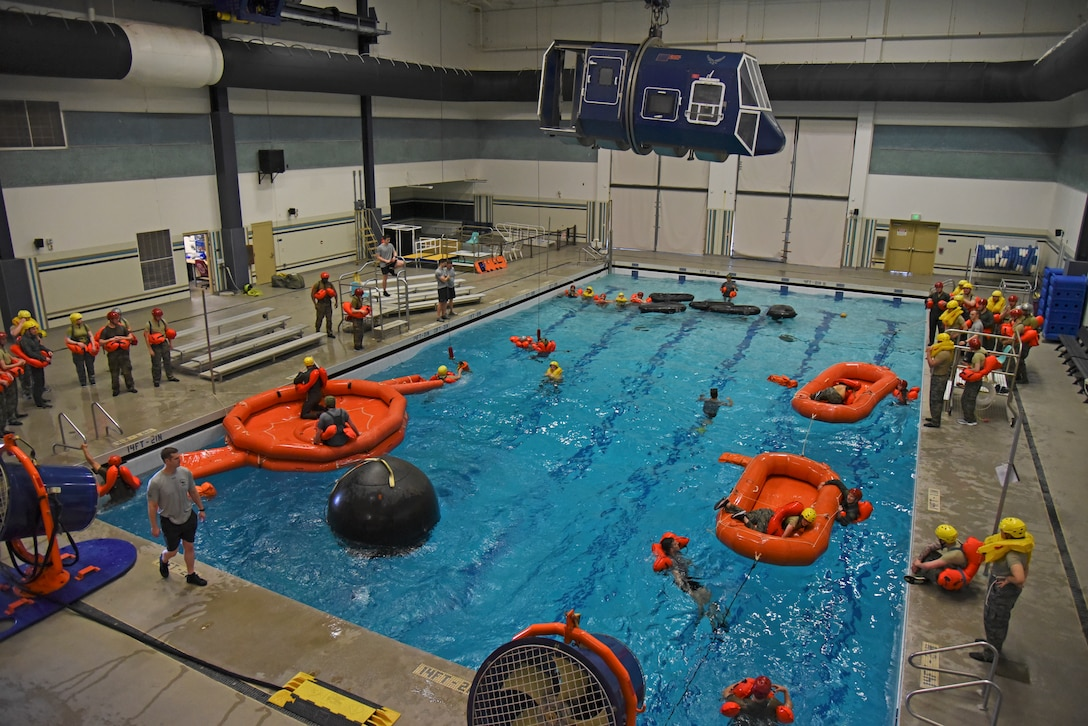 Survival, Evasion, Resistance and Escape specialists assigned to the 336th Training Group conduct water survival training with a class of 43 aircrew members at Fairchild Air Force Base, Washington, March 21, 2019. The primary focus of water survival training is to prepare aircrew members for emergency aircraft situations and surviving on the ocean until they can be rescued and recovered. (U.S. Air Force photo by Staff Sgt. Mackenzie Mendez)
