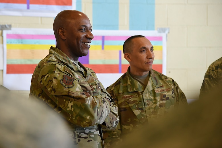 Chief Master Sgt. of the Air Force Kaleth O. Wright and Chief Master Sgt. Manuel Pineiro, Air Force first sergeant special duty manager, meet with 92nd and 141st Maintenance Group Airmen to discuss the streamlining of the periodic inspection process at Fairchild Air Force Base, March 22, 2019. The periodic inspection is the most in-depth inspection Fairchild maintainers conduct on the KC-135 Stratotanker. The two-week inspection is conducted every 24 months, 1,800 flight hours or 1,000 landings. (U.S. Air Force photo by Staff Sgt. Mackenzie Mendez)