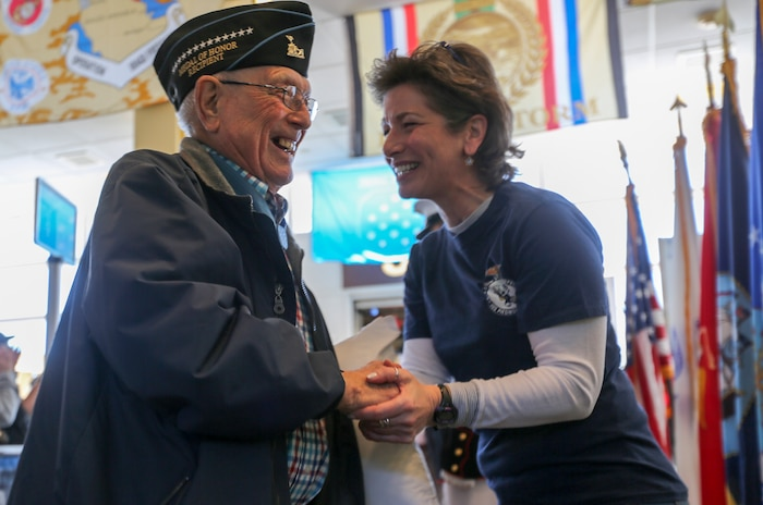 """Hershel """"Woody"""" Williams, the last living Medal of Honor recipient from the Battle of Iwo Jima and retired Marine Chief Warrant Officer 4, is greeted by a volunteer during the annual Medal of Honor (MoH), Honor Flight at Ronald Reagan National Airport, Washington, D.C., March 23, 2019."""