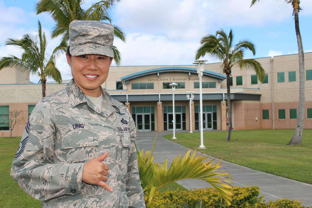 Photo of Chief Master Sergeant Nina Ung, the Directorate of Operations Senior Enlisted Leader in National Security Agency Hawai'i (NSA-H), standing in front of the Captain Joseph J. Rochefort Building at NSA-H.