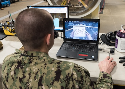 PANAMA CITY, Florida – Research Physiologist Lt. Travis Doggett monitors retinal tracking of the aircrew during flight in the Fluctuating Altitude Simulation Technology (FAST) system Jan. 14, 2019 at Navy Experimental Diving Unit. The system was developed and built by Naval Surface Warfare Center Panama City Division.