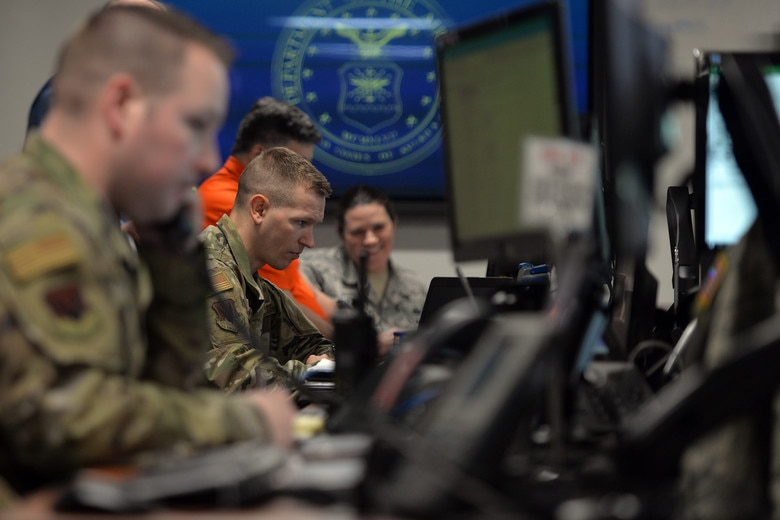 Master Sgt. Luke Nelson, 55th Force Support Squadron superintendent, acts as the first-source of flood information for the 55th FSS from the Recovery Operations Center March 19, 2019. The 55th Wing experienced record flooding as a result of unprecedented snowfall coupled with a dam in the northern part of the sate that failed. (U.S. Air Force photo by Josh Plueger)