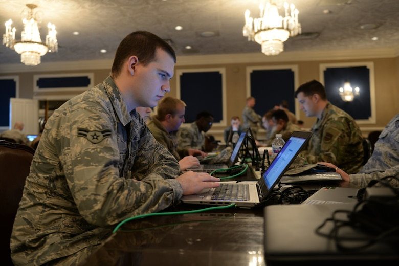 Members of the 55th Communications Group use temporary workstations in the Warhawk Community Center March 22, 2019, on Offutt Air Force Base, Neb.
