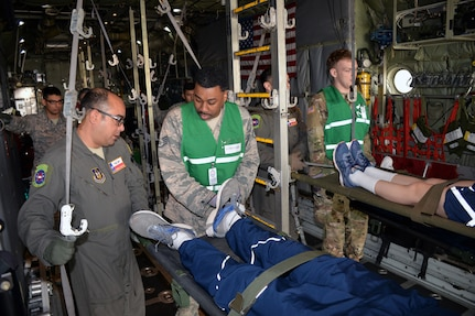 433rd Aeromedical Evacuation Squadron, 59th Medical Wing, and Brooke Army Medical Center personnel prepare to unload simulated litter patients during a National Disaster Medical System exercise at Joint Base San Antonio-Lackland March 20.