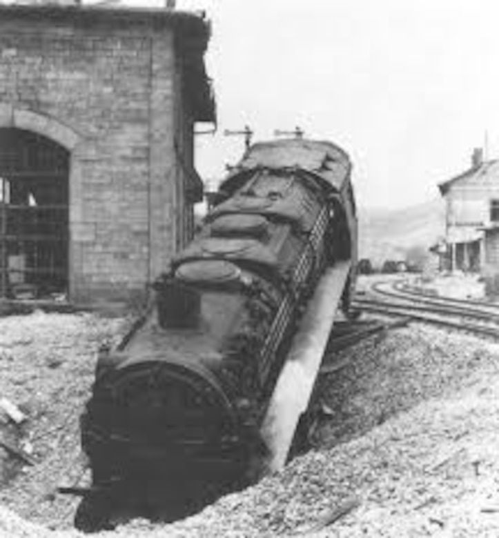 A French locomotive knocked off the tracks at a French rail center after an aerial attack. During the conduct of the Transportation Plan, Allied planners discovered that the German authorities could relatively replace destroyed and damaged freight cars by transferring freight cars from Germany and further east to France. However, destroyed or heavily damaged locomotives were not as easily replaced as the freight cars. (USAAF archival photo)