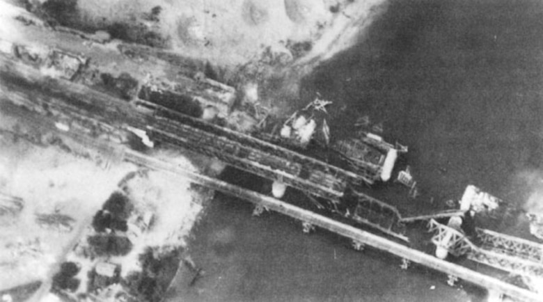 An Allied attack on the bridge over the Seine River at Oissell, France, on May 9, 1945, made the bridge unusable. German forces could not repair the Seine bridges fast enough to keep up with their damage/destruction in spring 1944. (USAAF archival photo)