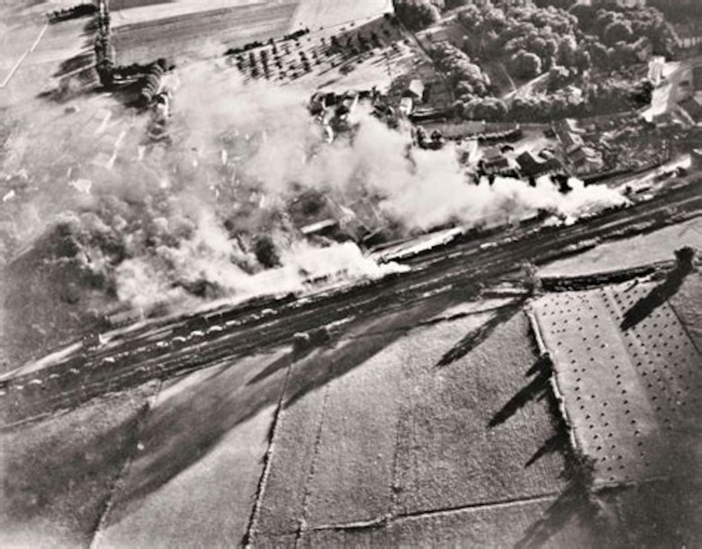 A photograph, taken by the gun camera of a P-47 Thunderbolt, showing the aircraft strafing a French freight train. The Republic P-47 Thunderbolt was one of the primary tactical aircraft used by the U.S Army. Air Forces for attacks on railyards, freight trains and military airfields during the implementation of the Transportation Plan. (USAAF archival photo)