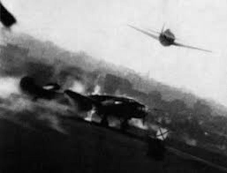 A photograph, taken by the gun camera of a P-47 Thunderbolt, of an American strafing attack on a German airfield in France. In addition to attacks on transportation targets, Allied aircraft attacked German airfields in France and Belgium. These attacks, combined with the intensifying strategic bombing of industrial targets and cities in Germany, forced the Luftwaffe to withdraw most of their fighters from Western Europe back to Germany. (USAAF archival photo)