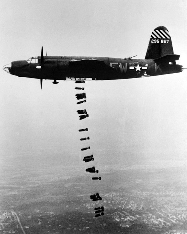 The twin-engine Martin B-26 Marauder medium bomber, assigned to Ninth Air Force, dropping a string of bombs during a mission. The Marauder, flying at medium altitudes of 10,000 to 15,000 feet with fighter escorts proved to be the most accurate attack aircraft used during the conduct of the Transportation Plan. (USAAF archival photo)