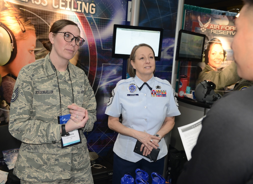 Tech Sgt. Valerie Droegemuller, an active duty Air Force recruiter, and Senior Master Sgt. Deserie Jackson, a Reserve recruiter, work side-by side during the Women in Aviation International conference as part of a total force team of recruiters in Long Beach, Calif. March 14-16, 2019. (Air Force photo/Master Sgt. Chance Babin)