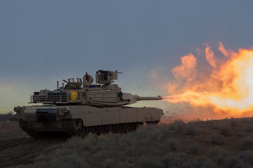 Fire bursts from a tank's main gun.