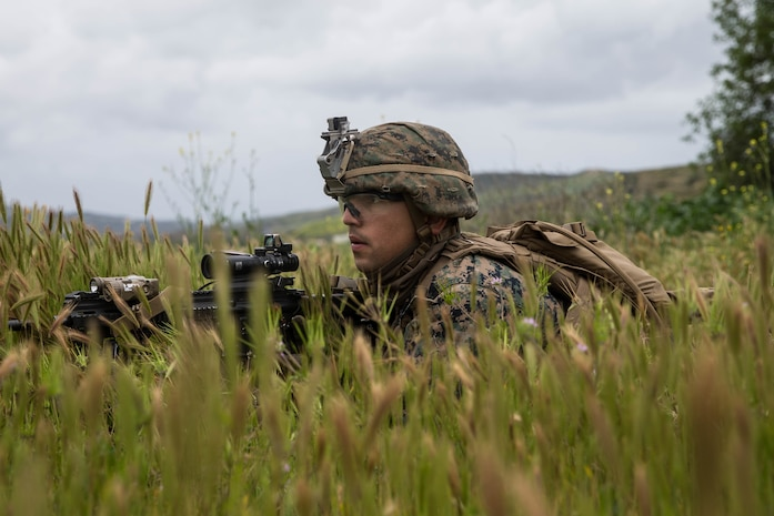 U.S. Marine Corps Pfc. Aaron Rivera, a rifleman with 2nd Battalion, 4th Marine Regiment, 1st Marine Division, provides security during the Infantry Integration with Counterintelligence/Human Intelligence Operations at Marine Corps Base Camp Pendleton, California, March 21, 2019. TACEX 19.2 is an exercise for infantry and CI/HUMINT to tailor patrols for both units to effectively locate and sustain possible threats in order to properly train participants for combat deployments.