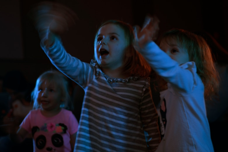 Children wave to Elmo during a Sesame Street Live performance at the base theatre March 23, 2019, at the theatre on Malmstrom Air Force Base, Mont.