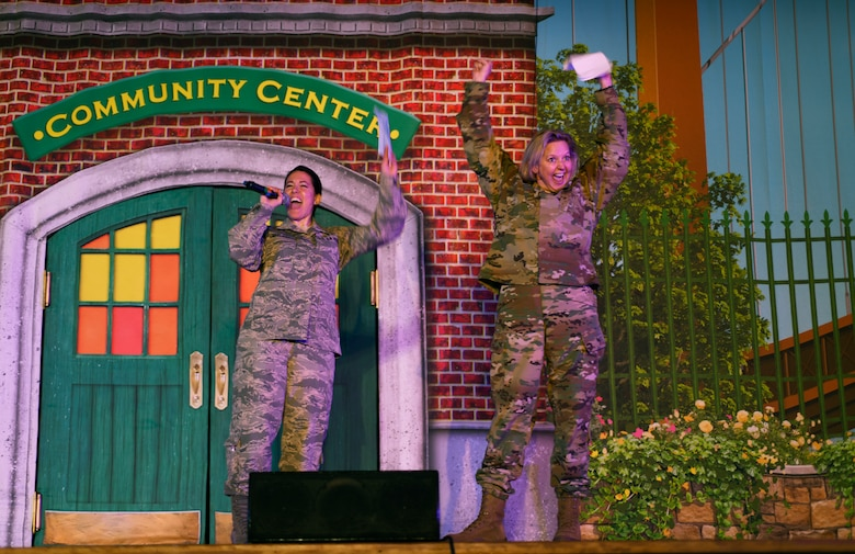 Col. Jennifer Reeves, 341st Missile Wing commander, and Chief Master Sgt. Eryn McElroy, 341st MW command chief, welcome a Sesame Street Live performance at the base theater March 23, 2019, on Malmstrom Air Force Base, Mont.