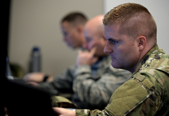 "Members of the 90th Cyberspace Operations Squadron participate in the monthly 567th Cyberspace Operations Group ""hunt exercise"" at Joint Base San Antonio-Lackland, Texas, March 21, 2019. The three-day exercise afforded teams from the 90th, 92nd, 833rd and 834th COSs, as well as the Air Force Office of Special Investigations, the opportunity to defend against an enemy within a virtual training network. (U.S. Air Force photo by Tech. Sgt. R.J. Biermann)"
