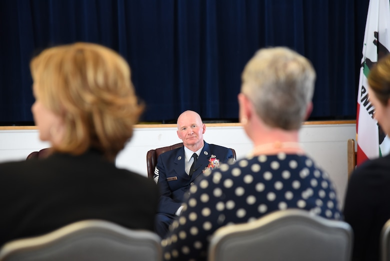 Chief Master Sgt. Thomas F. Good, 20th Air Force command chief,  watches his wife, Tennie Good, as she is recognized during his retirement ceremony March 5, 2019, at F. E. Warren Air Force Base, Wyo. Chief Good retired as the 20th Air Force command chief in the presence of his wife, children and friends. (U.S. Air Force photo by Senior Airman Nicole Reed)