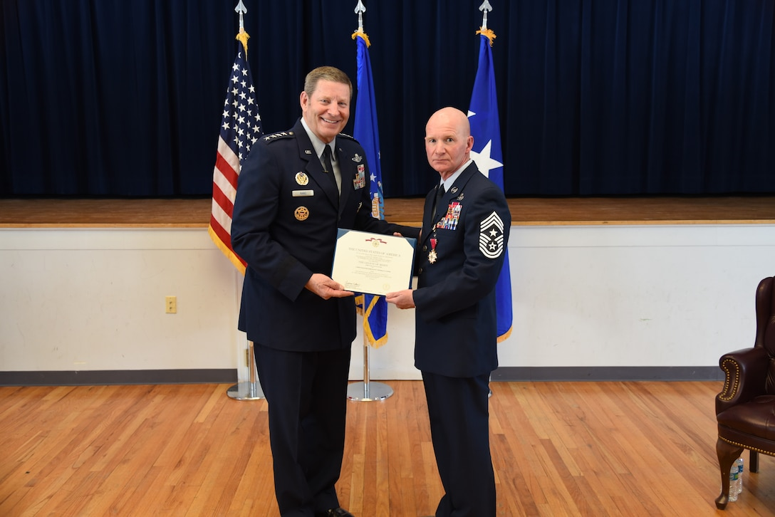 Retired Gen. Robin Rand presents a certificate to Chief Master Sgt. Thomas F. Good, 20th Air Force command chief, during Chief Good's retirement ceremony March 5, 2019, at F. E. Warren Air Force Base. Chief Good retired as the 20th Air Force command chief in the presence of his wife, children and friends. (U.S. Air Force photo by Senior Airman Nicole Reed)