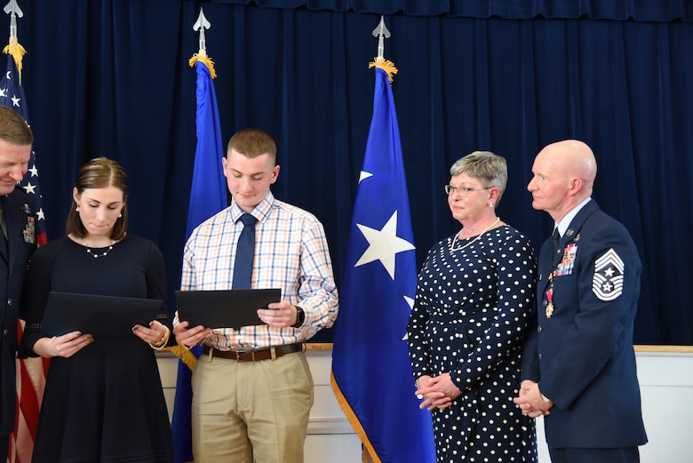 Chief Master Sgt. Thomas F. Good, 20th Air Force command chief, looks on as his children receive certificates of appreciation during his retirement ceremony March 5, 2019, at F. E. Warren Air Force Base, Wyo. Chief Good retired as the 20th Air Force command chief in the presence of his wife, children and friends. (U.S. Air Force photo by Senior Airman Nicole Reed)