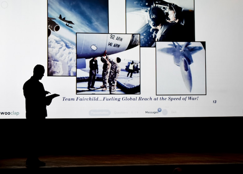 """U.S. Air Force Col. Derek Salmi, 92nd Air Refueling Wing commander, reviews key points of full spectrum readiness during a """"State of the Wing"""" all-call at Fairchild Air Force Base, Washington, March 20, 2019. Salmi gave recognition to Team Fairchild's recent accomplishments continuation of Fairchild's legacy of excellence. (U.S. Air Force photo by Airman 1st Class Whitney Laine)"""