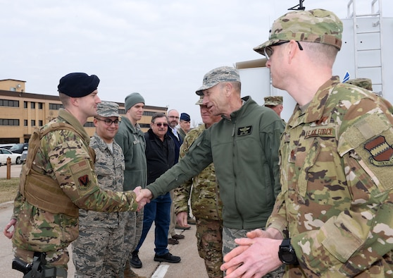 U.S. Air Force Gen. Mike Holmes, commander of Air Combat Command, thanks U.S. Air Force Staff Sgt. Michael Buchanan, 55th Security Forces Squadron, for his flood preparation efforts during the general's visit to Offutt Air Force Base, Nebraska, March 25, 2019. Just 10 days earlier, the base began taking on water, which eventually covered one-third of the installation. (Photo by Charles Haymond)