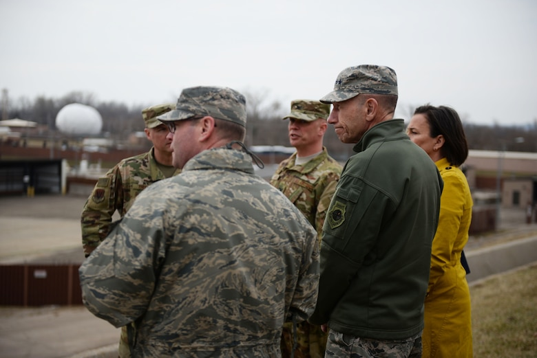 U.S. Air Force Gen. Mike Holmes, commander of Air Combat Command, looks over the damage caused by flooding during his visit March 25, 2019, to Offutt Air Force Base, Nebraska. He stopped by the base to get an up-close assessment and to thank those who worked to fortify the base before the water hit and those who are supporting its recovery efforts. (Photo by Tech. Sgt. Rachelle Blake)