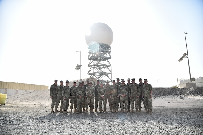 727th Expeditionary Air Control Squadron Airmen, deployed from the Utah Air National Guard, pose for a group photo with UTANG leadership at Al Dhafra Air Base, United Arab Emirates, Mar. 14, 2019. UTANG was founded on November 18, 1946, and consists of nearly 1,500 trained men and women who defend the United States of America. (U.S. Air Force photo by Senior Airman Mya M. Crosby)