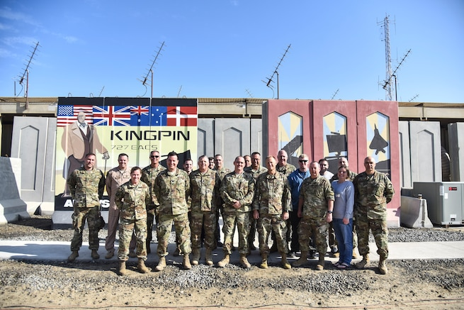 727th Expeditionary Air Control Squadron Airmen, deployed from the Utah Air National Guard, pose for a group photo with UTANG leadership at Al Dhafra Air Base, United Arab Emirates, Mar. 14, 2019. Since September 11, 2001, UTANG members have been activated and deployed for worldwide duty to include Operations Noble Eagle, Enduring Freedom and Iraqi Freedom. (U.S. Air Force photo by Senior Airman Mya M. Crosby)