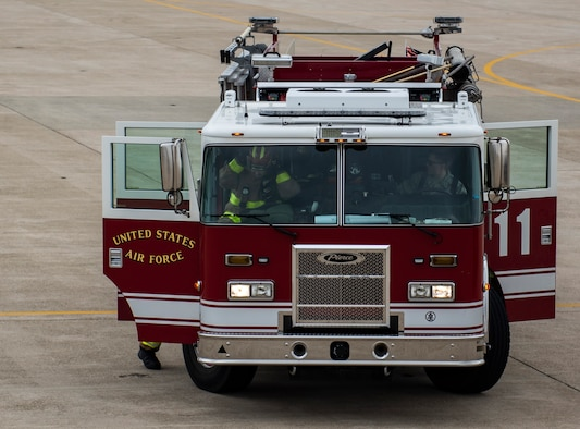 Fire fighters from the 8th Civil Engineer Squadron disembark their fire truck at Kunsan Air Base, Republic of Korea, March 26, 2019. Fire fighters have six minutes to respond to a fall victim being suspended by their safety harness before the situation can become life-threatening. (U.S. Air Force phot by Senior Airman Stefan Alvarez)