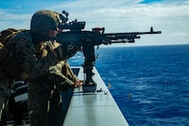 Lance Cpl. Caleb E. Engelhardt, a machine gunner with Bravo Company, Battalion Landing Team, 1st Battalion, 4th Marines fires an M240B medium machine gun while aboard the USS Green Bay, underway in the Pacific Ocean, March 14, 2019. Engelhardt, a native of Joliet, Illinois, graduated Plainfield South High School in May 2017 before enlisting in September later that year. The 31st Marine Expeditionary Unit, the Marine Corps' only continuously forward-deployed MEU, provides a flexible and lethal force ready to perform a wide range of military operations as the premier crisis response force in the Indo-Pacific region.