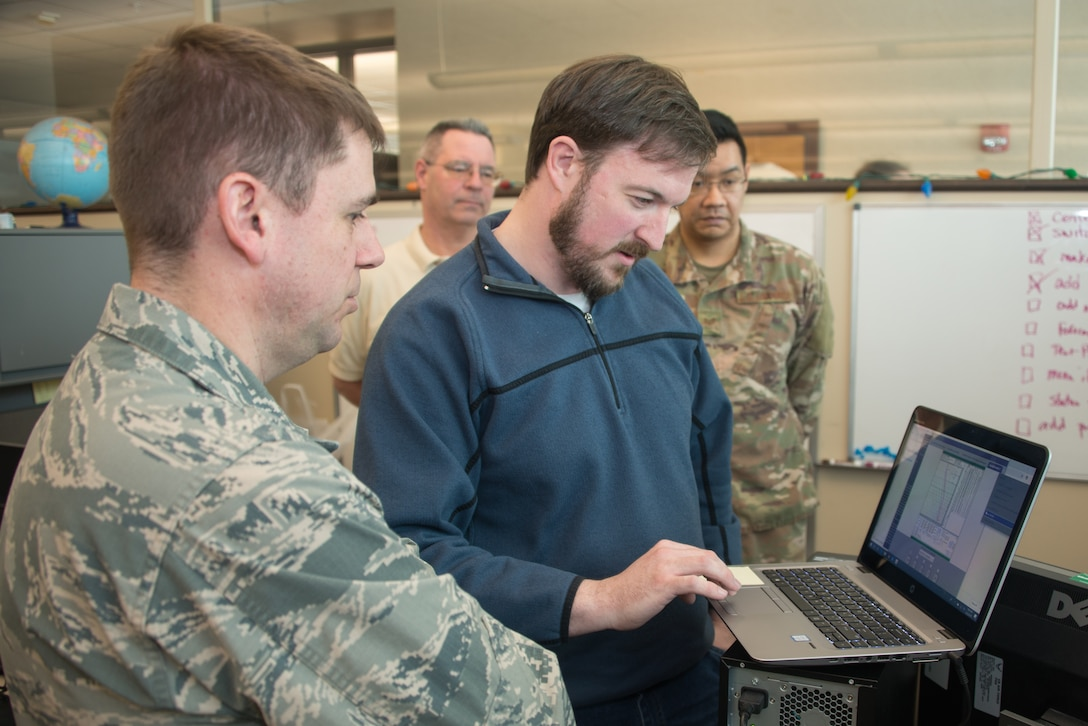 Airmen from the 16th Weather Squadron test software written as part of Exercise Adaptive Lightning 19, Task Force Bat Phone, at Offutt Air Force Base, Nebraska, Feb. 26, 2019. Task Force Bat Phone is a 2nd Weather Group project that uses off-the-shelf technology combined with rapid development techniques to deliver new communication capabilities to deployed forecasters in contested, degraded or operationally-limited environments. (U.S. Air Force photo by Paul Shirk)