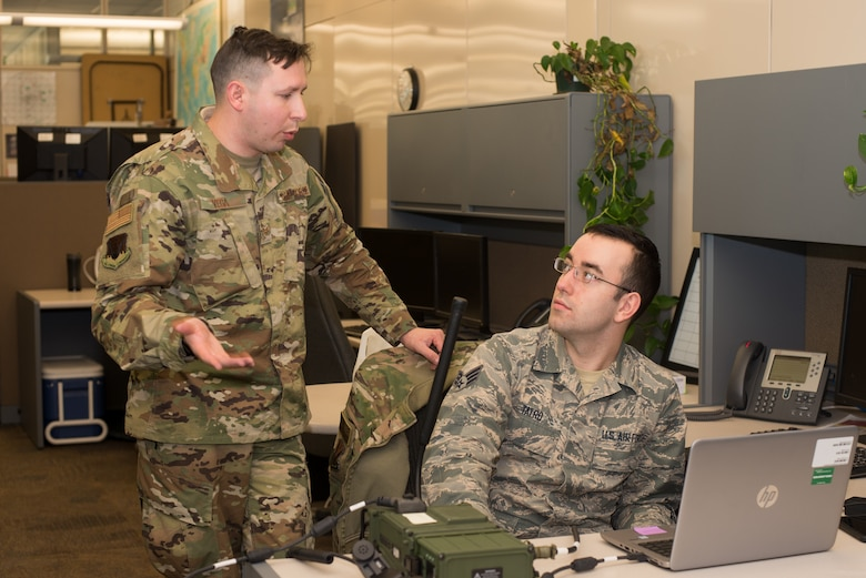 Staff Sgt. Victor Vega, 2nd Combat Weather Systems Squadron weather systems trainer, and Senior Airman Erik Tatro, 2nd Systems Operations Squadron alphanumerics collection technician, prepare for a test of the Exercise Adaptive Lightning 19, Task Force Bat Phone, at Offutt Air Force Base, Nebraska, Feb. 26, 2019. Using agile development techniques, the development team was able to successfully write and test a proof of concept in only seven weeks. (U.S. Air Force photo by Paul Shirk)