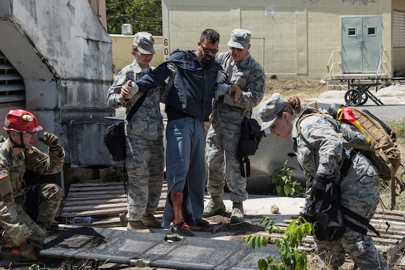 U.S. Airmen and Soldiers from the 3rd Chemical, Biological, Radiological, Nuclear Task Force, Pennsylvania National Guard, help evacuate a casualty actor during the exercise Vigilant Guard.