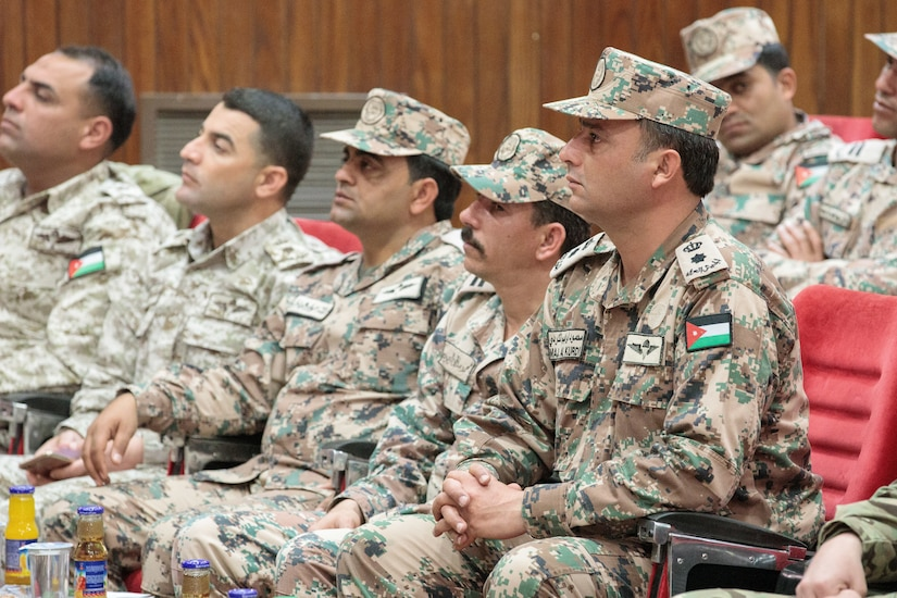 Jordan Armed Forces soldiers listen to a guest speaker during a graduation ceremony for the JAF 10th Border Guard Force Battalion at the Peace Operations Training Center near Amman, Jordan, March 14, 2019. The 10th BGF graduated from the Joint Operational Engagement Program where they trained with the California Army National Guard's 1st Squadron, 18th Cavalry Regiment for ten weeks to enhance the BGF readiness to protect and secure Jordan's borders.
