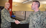 Distribution's Champine receives commander's coin