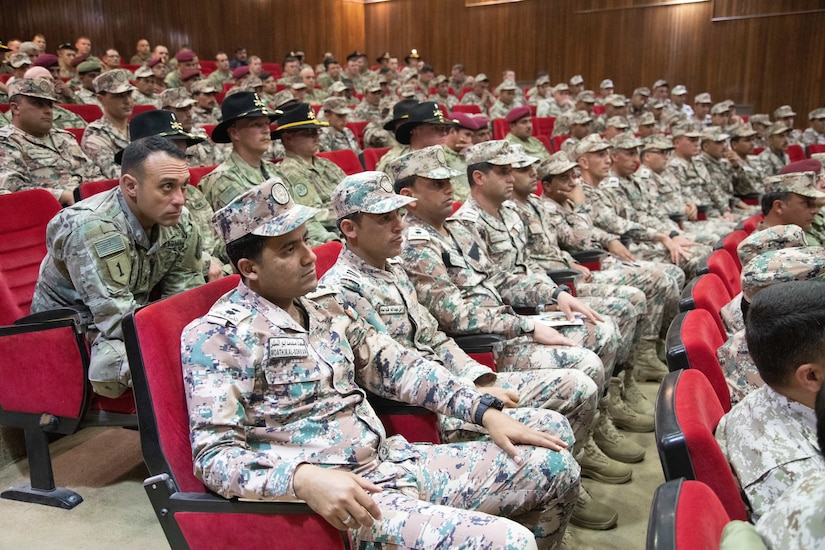 U.S. Army and Jordan Armed Forces soldiers listen to a guest speaker during a graduation ceremony for the JAF 10th Border Guard Force Battalion at the Peace Operations Training Center near Amman, Jordan, March 14, 2019. The 10th BGF graduated from the Joint Operational Engagement Program where they trained with the California Army National Guard's 1st Squadron, 18th Cavalry Regiment for ten weeks to enhance the BGF readiness to protect and secure Jordan's borders.