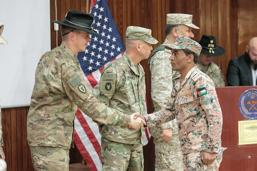 U.S. Army Lt. Col. Jeremy T. Hopkins, 1st Squadron, 18th Cavalry Regiment, commander, Brig. Gen. Michael D. Wickman, deputy commanding general-maneuver, 34th Infantry Division Forward, Jordan, and Jordan Armed Forces Brig. Gen. Khalid Mohammed Al-Masaeid, Northern Region commander, congratulate company commanders in the 10th Border Guard Force Battalion (BGF) during their graduation ceremony the Peace Operations Training Center near Amman, Jordan, March 14, 2019. The JAF soldiers' graduation from the Joint Operational Engagement Program signified the completion of a 10-week training program with the California Army National Guard's 1-18 CAV to develop and strengthen soldier skills for the 10th BGF.