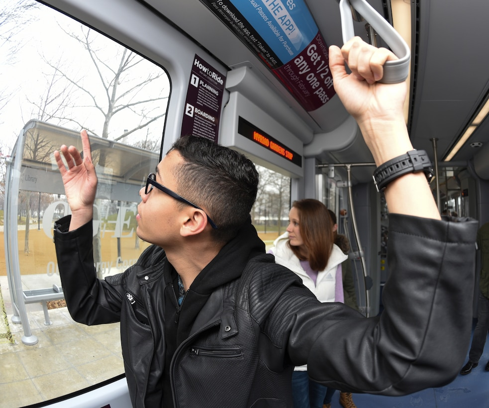 Airman 1st Class Willblas Coriano-Cotto, 552nd Operations Support Squadron intelligence analyst, points out the window of an Oklahoma City Streetcar as it passes a landmark during Tinker Air Force Base's First Term Airmen Center tour of the downtown area on March 8, 2019, Oklahoma City, Oklahoma.