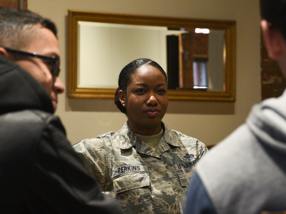 Chief Master Sgt. Shakeisha Perkins, 72nd Force Support Squadron superintendent, talks with Airmen in a relaxed setting at the Bricktown Brewery restaurant, during Tinker Air Force Base's First Term Airmen Center downtown tour.