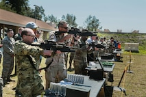 U.S. and coalition military personnel from U.S. Central Command, U.S. Special Operations Command and MacDill Air Force Base fire non-lethal weapons during a familiarization fire at MacDill AFB, March 21, 2019.