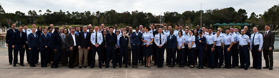 The 71st class of Air Force Education With Industry Fellows gathered in Orlando, Florida to share their company experiences with leadership from Air Force Acquisition (SAF/AQH and SAF/AQX), Manpower, Personnel and Services (HAF/A1D), Air Force Institute of Technology, and the Air Force Personnel Center as part of their DoD mandated Mid Tour Review. (U.S. Air Force Photo by Capt Frank Larkins)