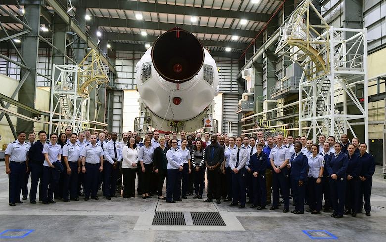 EWI Fellows posed in front of a Delta IV Medium Booster - GPS III Mission.  During the EWI Mid Tour Review, Fellows toured both the United Launch Alliance and Lockheed Martin Missiles & Fire Control facilities.  Senior leadership from both companies took the time to provide their perspective on partnering with industry and shared what's made them successful. (U.S. Air Force Photo by Capt Frank Larkins)