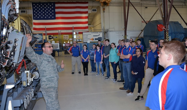 Master Sgt. Sean C. Preston, 433rd Maintenance Squadron propulsion mechanic, describes the features of a C-5M Super Galaxy engine to Burleson Independent School District Air Force Junior ROTC students March 22 at Joint Base San Antonio-Lackland. Fifty-four students and instructors from Burleson, Texas, attended the basic military training and toured several organization on base during their visit.