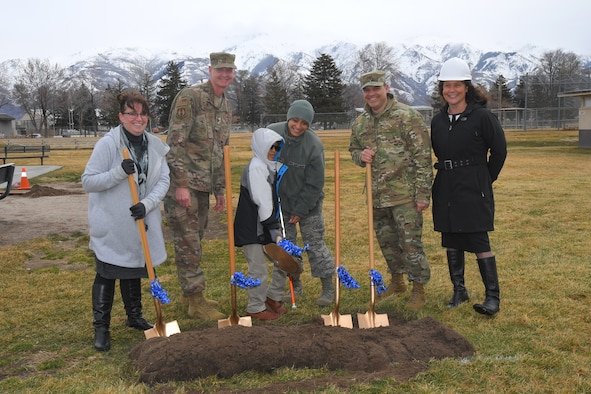 (Center) Keanu Clark and his mother, Tech. Sgt. Elentra Suafoa, 388th Fighter Wing, participate in a ground breaking for an all abilities playground March 21, 2019, at Hill Air Force Base, Utah. The playground will remove barriers of exclusion, both physical and social, and provide a sensory rich experience for children of all abilities. Playground completion is planned for June 2019. Also participating, (left to right) Tammy Custer, Exceptional Family Member Program specialist, Col. Jon Eberlan, 75th Air Base Wing commander, Col. Gabe Lopez, 75th Mission Support Group commander, and Ali Seligman, EFMP specialist. (U.S. Air Force photo by Todd Cromar)